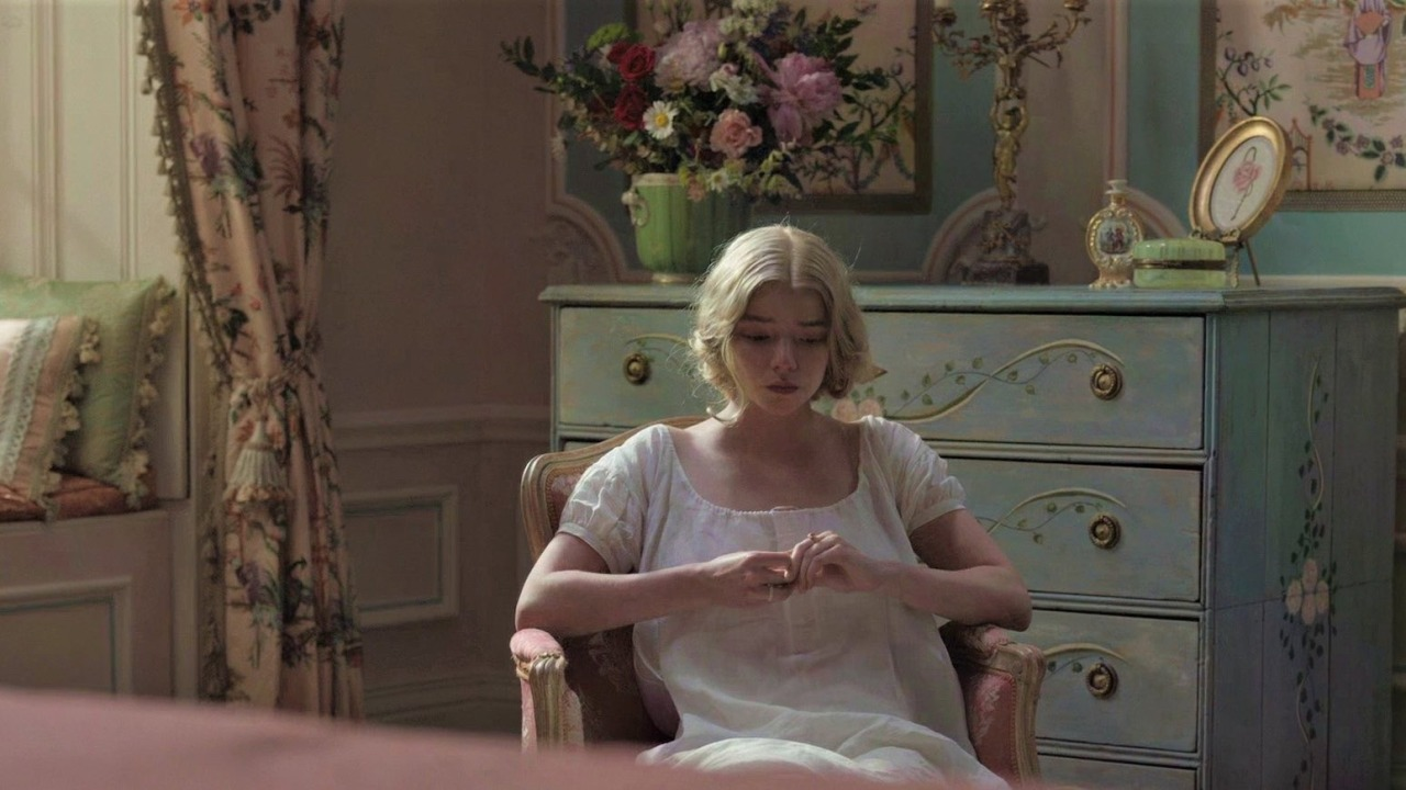 Emma sentada com uma expressão deprimida.