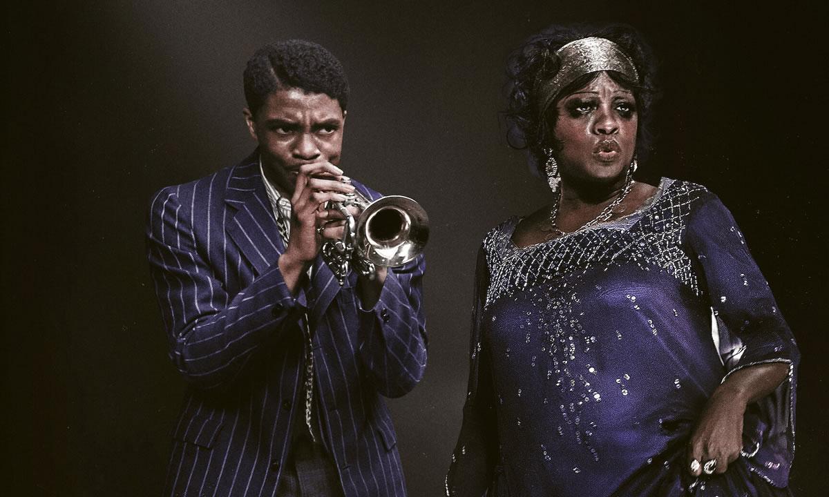 Na imagem, vê-se os dois protagonistas, o trompetista Levee (Chadwick Boseman) e a cantora Ma Rainey (Viola Davis), dividindo os holofotes do palco num concerto de blues.