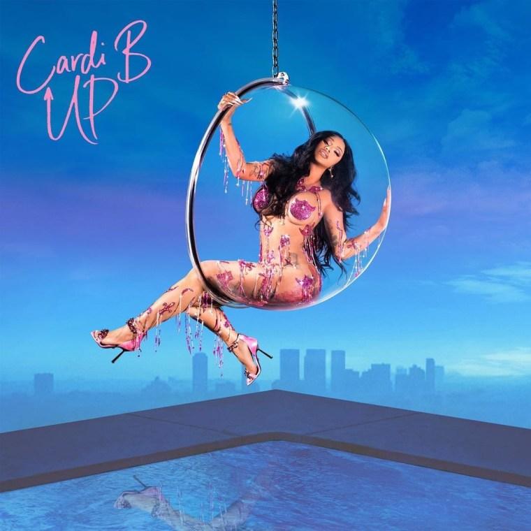 Capa do single Up, de Cardi B. Cardi B se encontra na parte superior da imagem, sustentada por uma rede de acrílico. Seus cabelos são pretos e longos. Sob Cardi, a imagem revela uma piscina. No fundo da imagem, se mostra uma cidade e o céu azul.