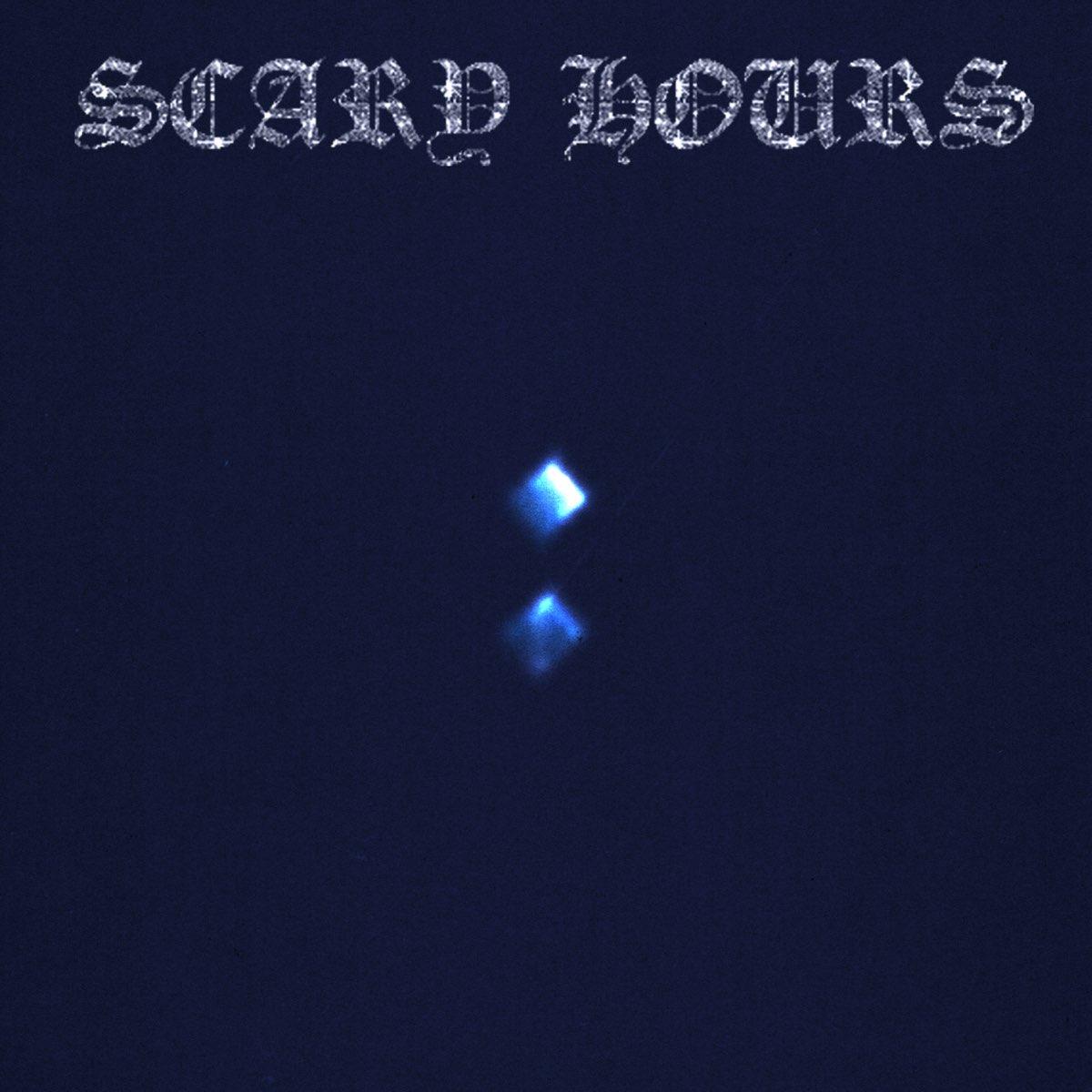 Capa do EP Scary Hours 2, do rapper Drake. A capa é toda azul escura. No topo, está escrito Scary Hours, num fonte super estilizada e com acabamento brilhante, semelhante a um diamante. No meio da capa, está dois quadrados azuis claro.