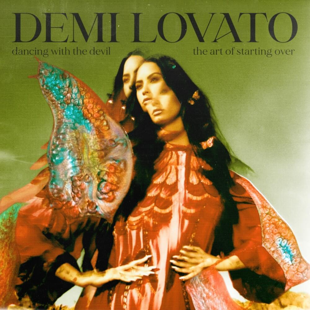 Capa do álbum 'Dancing With The Devil... The Art of Starting Over', de Demi Lovato. Nela, Demi Lovato está com as mãos em sua cintura, e ela usa um vestido kimono vermelho. A imagem é holográfica, e o corpo de Demi se repete três vezes sobre a o fundo verde. Seus cabelos são longos, na altura de sua costela, e sob suas madeixas existem pequenas borboletas de acessório.