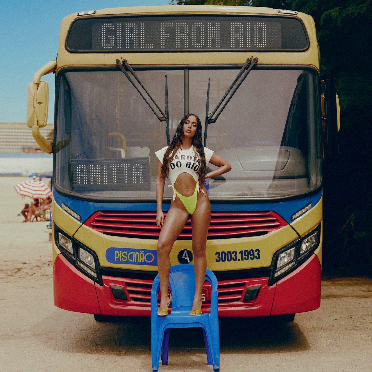 Capa do single Girl From Rio de Anitta. A cantora está em cima de uma cadeira azul de praia, vestindo um maiô verde fluorescente e um top branco escrito GAROTA DO RIO. Ela apoia o braço esquerdo na cintura. Atrás dela, podemos ver a frente de um ônibus amarelo, azul e vermelho, com o letreiro digital escrito GIRL FROM RIO. No letreiro do vidro, está escrito ANITTA. A cantora e o ônibus estão na areia do Piscinão de Ramos, no Rio de Janeiro.