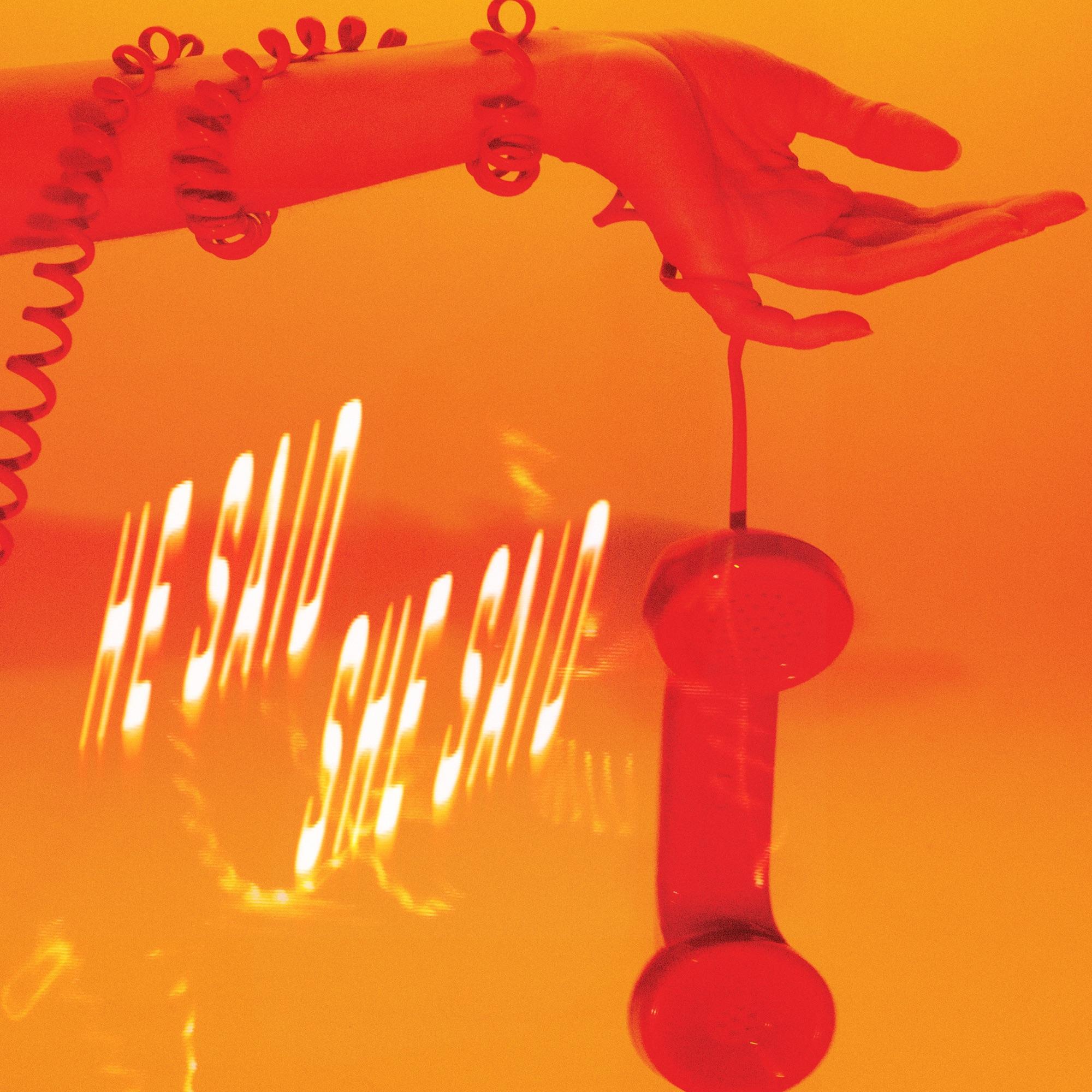 """Capa do single """"He Said She Said"""", da banda CHVRCHES. Uma mão se estende da esquerda para a direita, com a palma virada para cima e o fio de um telefone retrô se enrolando pelo abraço, com o telefone vermelho pendendo para baixo, segurado pelo dedo mindinho da mão. O título do single aparece no canto inferior esquerdo, abaixo do braço, em letras maiúsculas, inclinadas para a esquerda e que dão a impressão de estarem sendo espremidas. A capa toda é banhada em uma luz alaranjada, com o título em amarelo incandescente."""