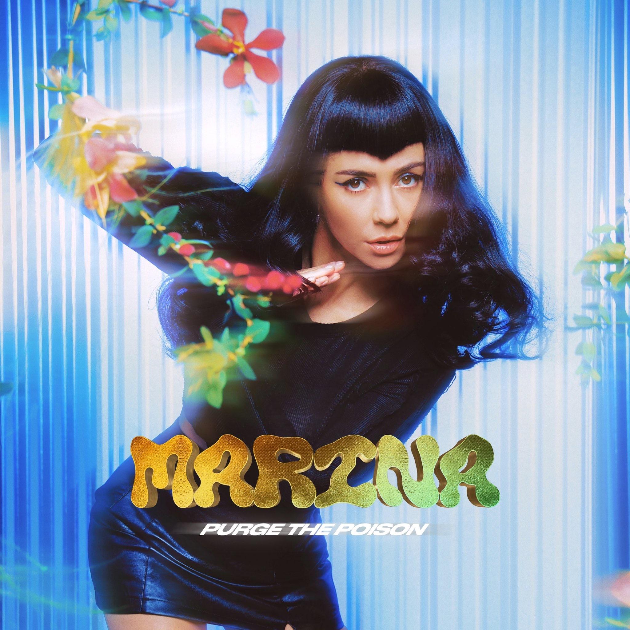 Capa do single Purge The Poison, de Marina. A cantora está ao centro, de roupa preta, usando um cabelo corte franjinha em V. Em volta dela, podemos ver flores coloridas. Ao fundo, há uma cortina azul clara iluminada. Foi adicionado em primeiro plano o nome da cantora e o título da canção.