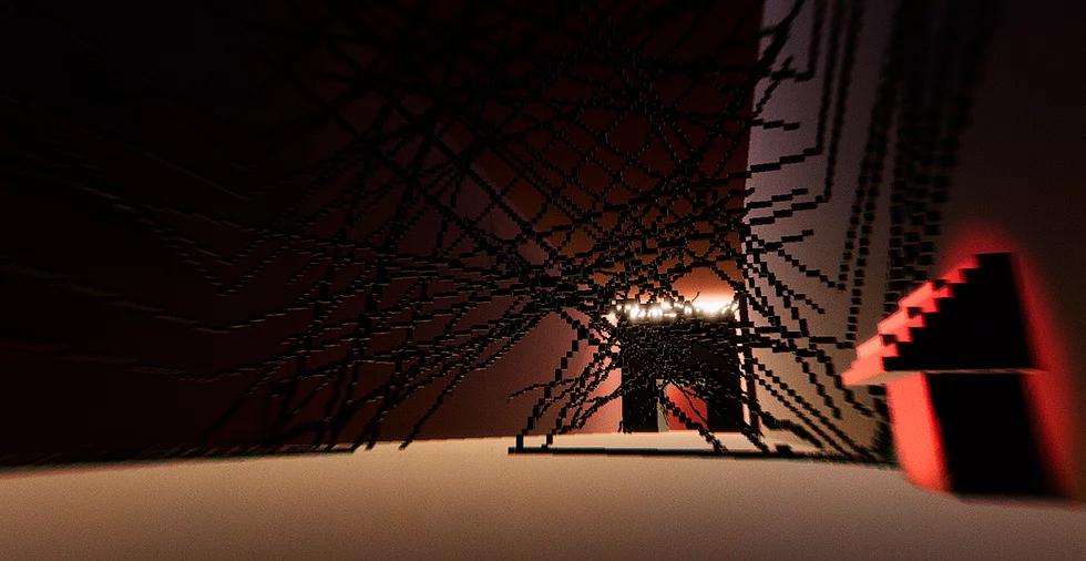 Imagem do game Bagata. Um corredor amplo inteiramente digital de paredes marrons é atravessado inúmeras vezes por linhas marrom-escuras diagonais formadas por pequenos blocos retangulares. No canto direito, uma estrutura que parece ser uma placa de informações inclinada na diagonal com uma base cúbica emana uma luz vermelha.