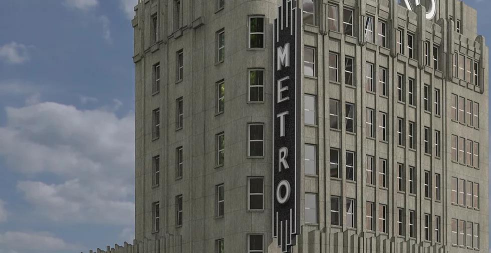 Imagem digital reconstruída do Cine Metro. Mostra parte de um prédio cinza de múltiplos andares e estilo art-déco. Um grande sinal preto na vertical acompanha o prédio com a palavra 'Metro'.