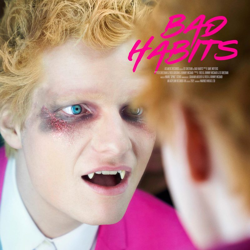 Capa quadriculada do single Bad Habits. Ed Sheeran está se olhando num espelho. Ele é branco, ruivo e usa lentes azuis claras. Ele está com sombra ao redor dos olhos preta acinzentada, com glitter vermelho. Ele está com a boca um pouco aberta, mostrando os caninos afiados. Ele veste um paletó pink e uma camisa social branca. No lado superior esquerdo, está escrito Bad Habits em rosa em letras maiúsculas, como se fossem grafitadas. Abaixo, bem pequeno e em branco, está escrito os créditos da composição de forma ilegível.