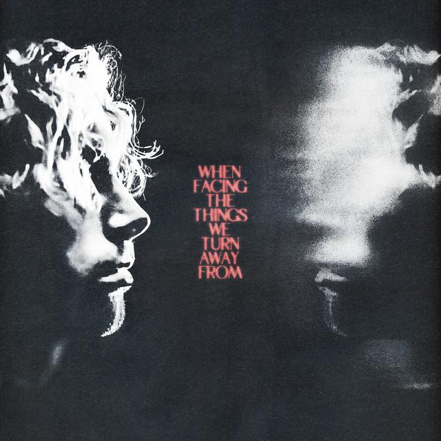 Capa do álbum When Facing The Things We Turn Away From. O cantor Luke Hemmings está de perfil no lado esquerdo da foto, olhando para a direita. Ele é branco e possui cabelos curtos cacheados. Os cachos cobrem seus olhos e sua boca está fechada, triste. Seu rosto está iluminado apenas de cima. Do lado direito da foto, está o reflexo do rosto de Luke com a área dos olhos borrados, No meio das duas imagens, está escrito o nome do álbum When Facing The Things We Turn Away From, um em cada linha, em letras maiúsculas e vermelhas, como um letreiro de cinema antigo.
