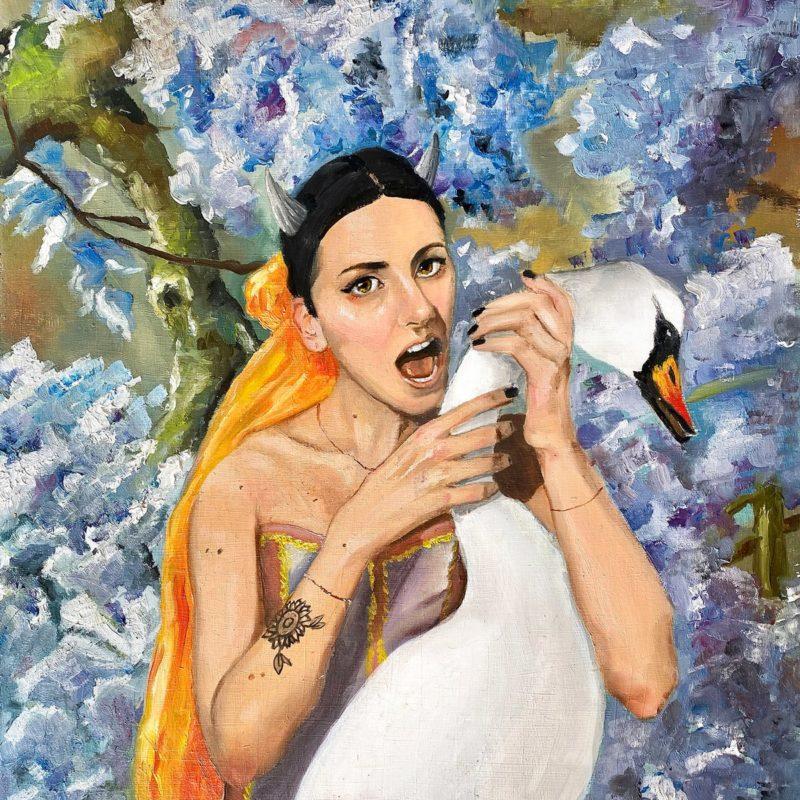 Capa do disco love and other disasters de iris. A imagem é o desenho de uma mulher branca, de cabelo preto e chifres prateados. Ela olha para frente enquanto abre a boca para morder um pato que está a sua frente, com uma expressão parecendo séria, ou triste. No fundo há uma árvore de folhas roxas.