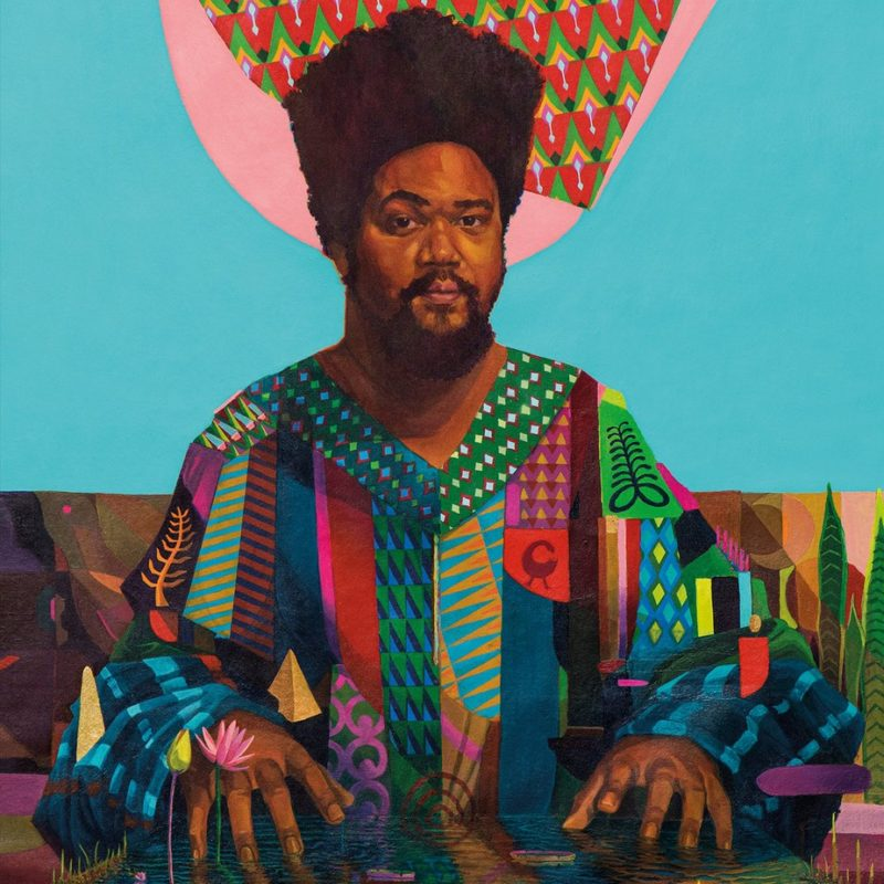 Capa do álbum Sankofa: é uma pintura de um homem negro de cabelo afro e barbicha. Ele está com uma postura sentada, mas as pontas dos dedos estão tocando uma superfície de água à sua frente,de onde sai uma flor e um broto no canto inferior esquerdo. Esse homem traja uma bata de gola V com tecido multicolorido e estampado cheio de símbolos e padrões. Atrás dele há uma representação de uma vegetação baixa e um amplo azul que emoldura a metade superior de sua figura, com exceção do topo de sua cabeça, onde há uma forma como uma auréola rosa junto a um padrão estampado semelhante aos vistos em sua roupa.