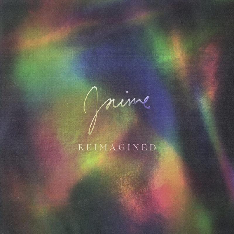 """Capa do álbum Jaime Reimagined, de Brittany Howard. A imagem é composta por um fundo prateado holográfico que reflete todas as cores do arco-íris sem uma linearidade definida. No centro, está escrito """"Jaime"""" numa fonte cursiva em prateado, e """"Reimagined"""" embaixo, numa fonte serifada em caixa alta e na mesma cor."""