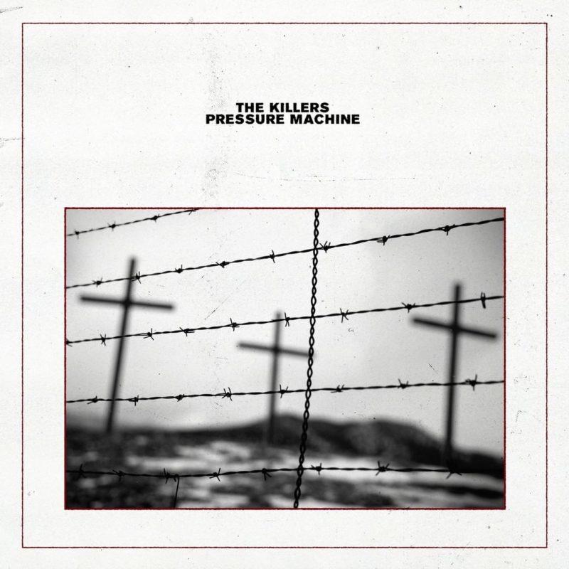 Capa do disco Pressure Machine, da banda The Killers. Na capa, de cor branca, há uma foto em preto-e-branco, que contém uma proteção de arame farpado ao centro, e três cruzes desfocadas ao fundo. O nome da banda e o nome do álbum estão acima da fotografia, escritos em fonte de cor preta