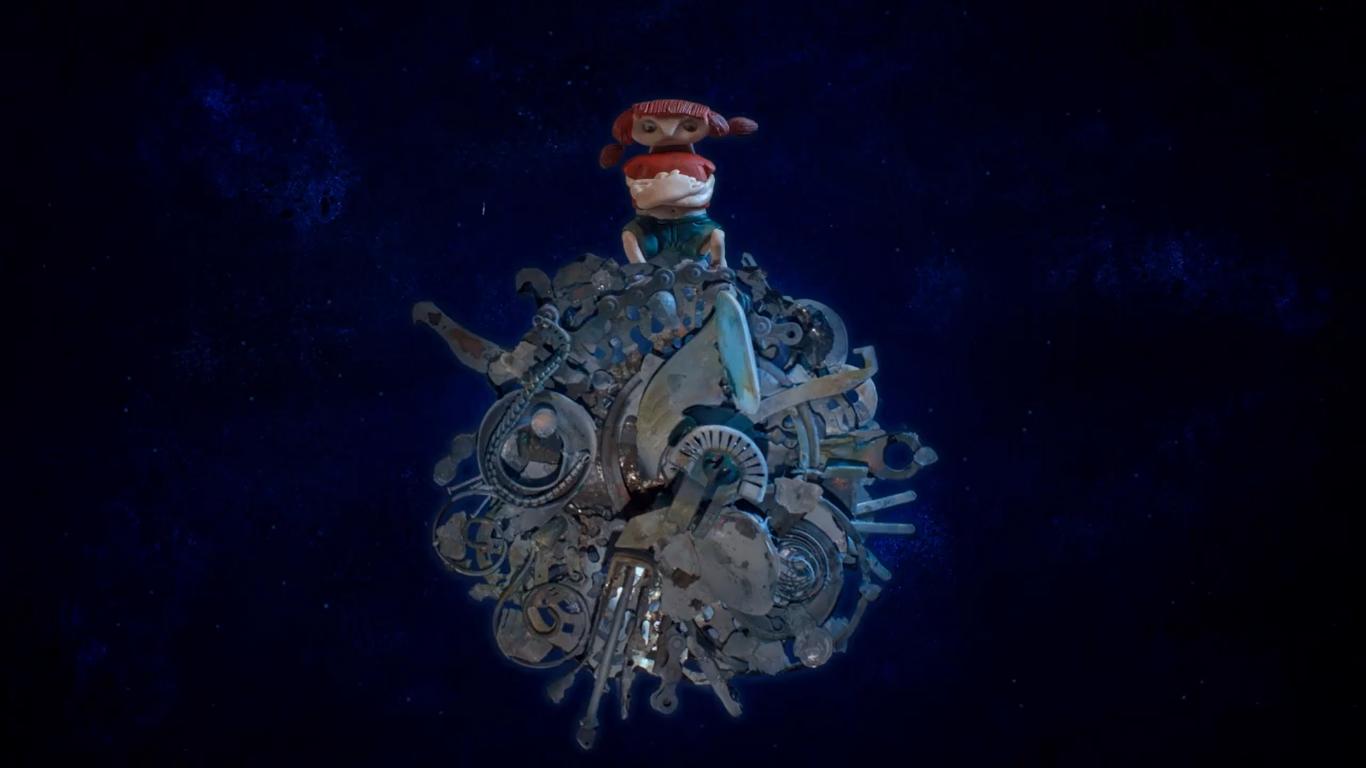 Cena do curta-metragem animação Ailin no mundo da lua. Ailin é uma menina branca, que está vestindo uma blusa vermelha e uma bermuda azul, seu cabelo é castanho, com uma franja e amarrado nas laterais. A garota está com os braços cruzados e brava. Está sentada em uma bola confeccionada com sucatas, a lua da narrativa, ao fundo se encontra um ambiente que remete ao universo, um mesclado de tons azuis e pretos com traços luminosos.
