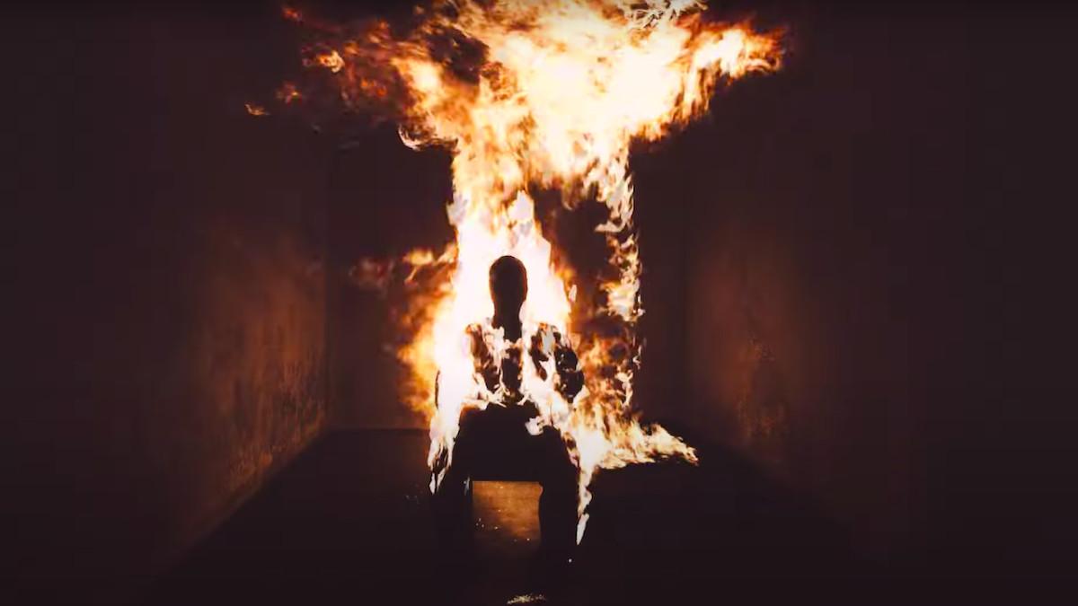 Imagem retirada da terceira audição do álbum Donda. Nela, vemos o interior de uma casa. No centro, vemos a silhueta de um homem sentado em uma cadeira. Ao redor de todo quarto, chamas começam a se espalhar, queimando a casa e o corpo do homem.