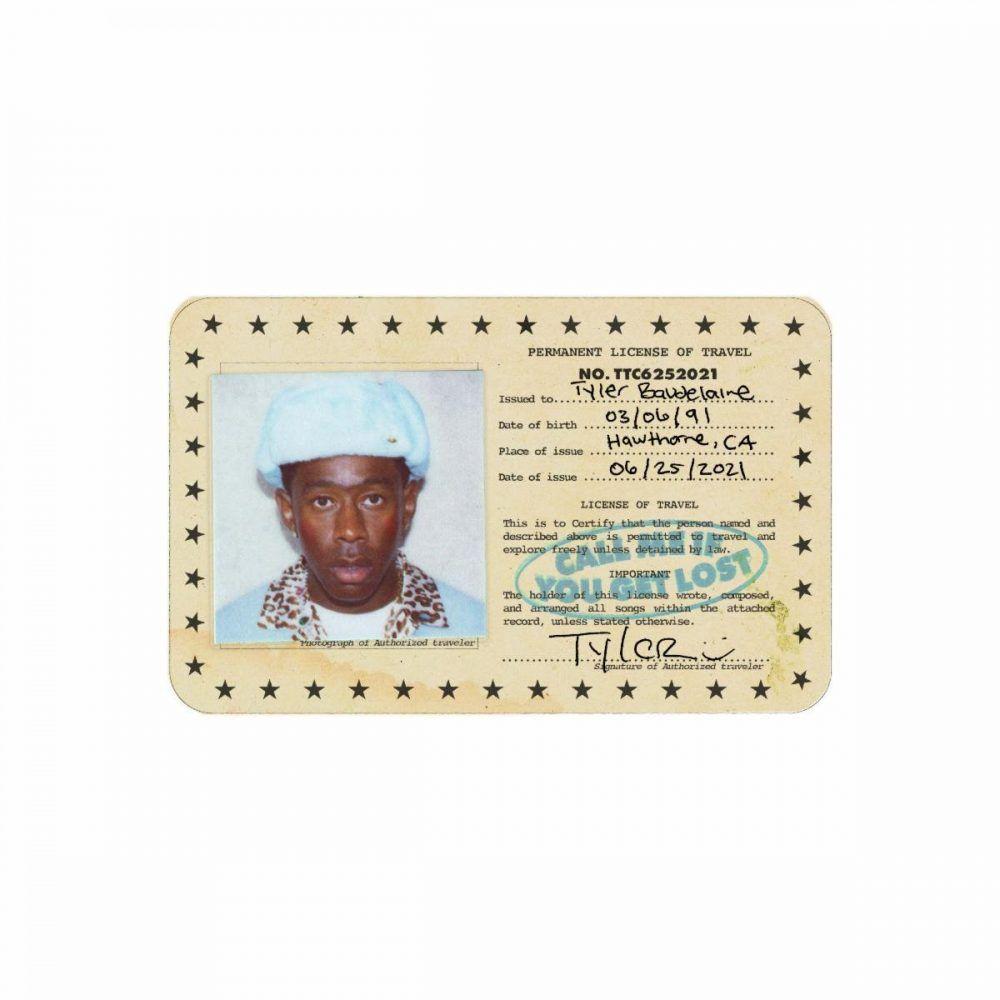 """Capa do disco CALL ME IF YOU GET LOST, de Tyler, The Creator. A imagem tem um fundo branco, onde está o que parece um passaporte plastificado. Nele, Tyler usa uma touca azul clara, no estilo chapéu soviético. Ele veste uma camisa da mesma cor, com golas estampadas com oncinhas e camiseta branca por baixo. O passaporte contém os dados e assinatura de Tyler Baudelaire, personagem do novo álbum. O título do projeto, """"Call me If You Get Lost"""", aparece em azul claro como um carimbo no passaporte."""